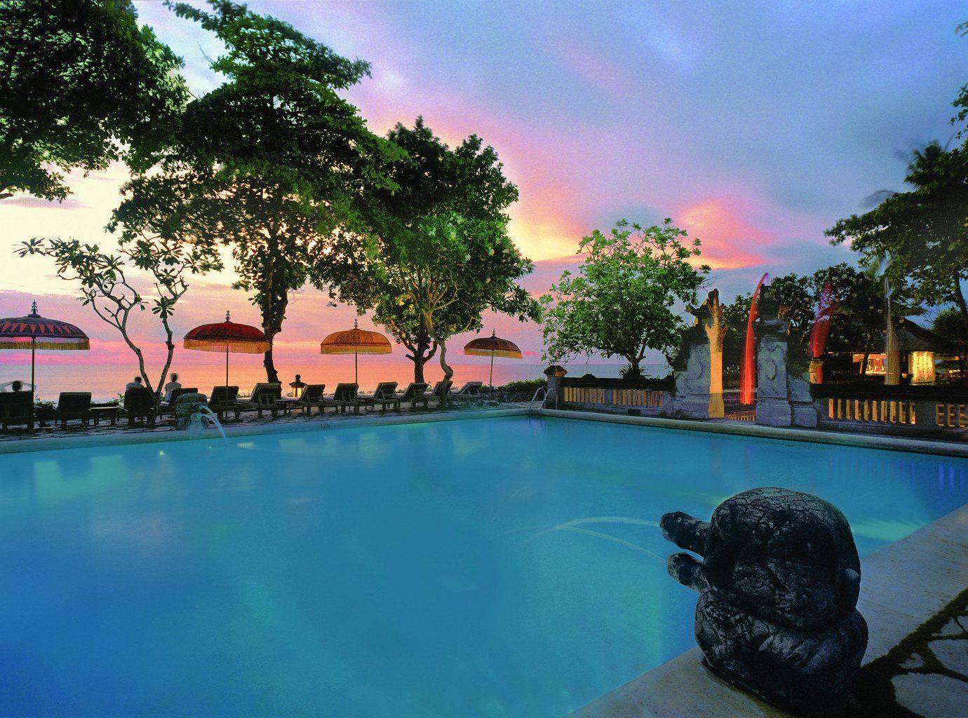 Beachfront Luxury Pool Sunset Trip Ideas tree outdoor swimming pool leisure Resort estate water sport vacation swimming mansion