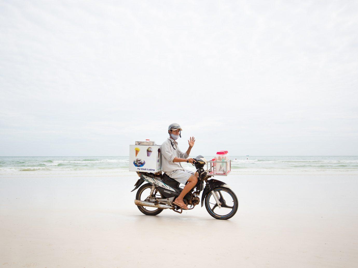 sky outdoor water Beach vehicle Sea Coast sand bicycle motorcycle shore sandy