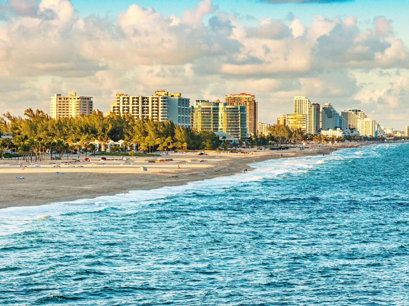Offbeat Travel Tips sky water outdoor horizon geographical feature Beach Sea City shore Coast skyline Ocean vacation human settlement bay cityscape caribbean wave Harbor
