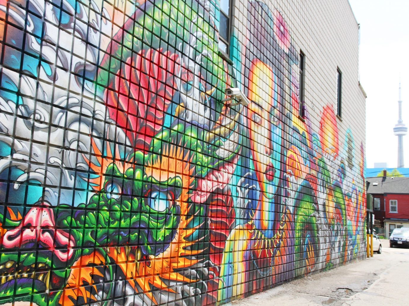 Offbeat Trip Ideas colorful outdoor graffiti wall neighbourhood art street art mural facade metropolis building window painted painting colored