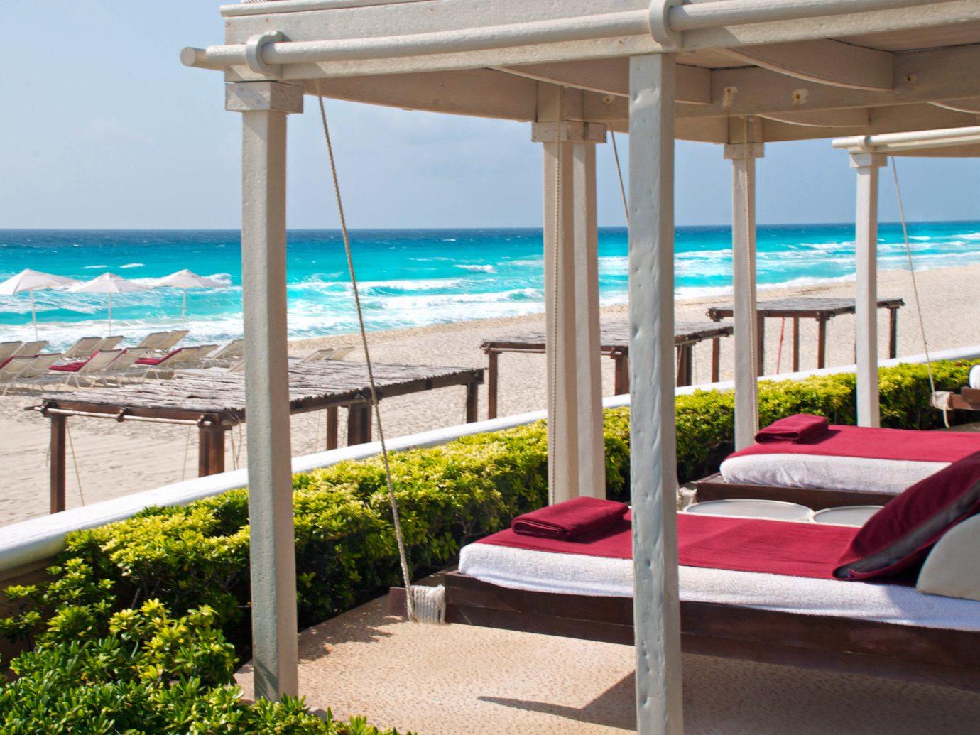 Beach Beachfront Lounge Luxury Ocean Trip Ideas outdoor chair umbrella property leisure lawn vacation Resort caribbean estate Villa real estate overlooking Pool Deck furniture shade shore day