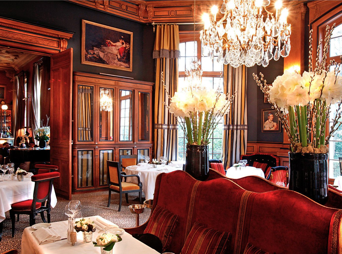 City Dining Drink Eat Elegant France Historic Hotels Lounge Paris Romantic indoor room window Living sofa chair restaurant ceiling dining room estate meal decorated red interior design home furniture function hall Bar nice living room mansion palace area leather
