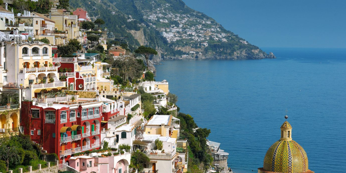 Buildings calm charming Cliffs europe Hotels houses isolation Jetsetter Guides landscape Ocean quaint remote Romance Scenic views serene view mountain water outdoor Town geographical feature landmark Coast vacation Sea tourism cityscape tower bay mountain range Village travel place of worship Island