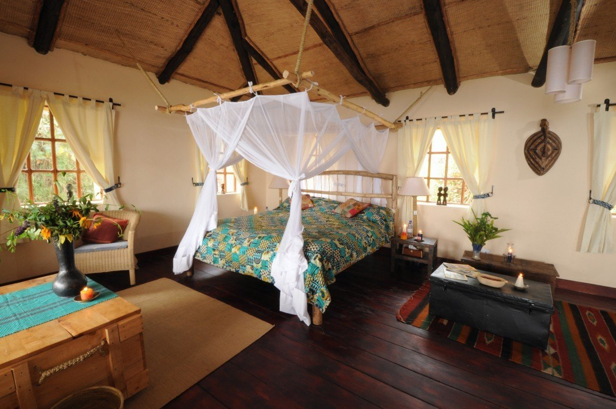 africa bed Bedroom calm canopy canopy bed charming cozy homey quaint remote Rustic serene Trip Ideas indoor floor room property cottage Villa estate Resort interior design farmhouse Suite wood furniture