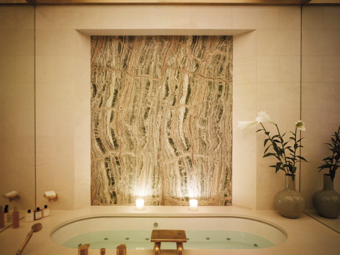 Hotels Luxury Travel wall bathroom indoor room interior design sink curtain window treatment window window covering flooring shade glass decor tub bathtub Bath tile tiled