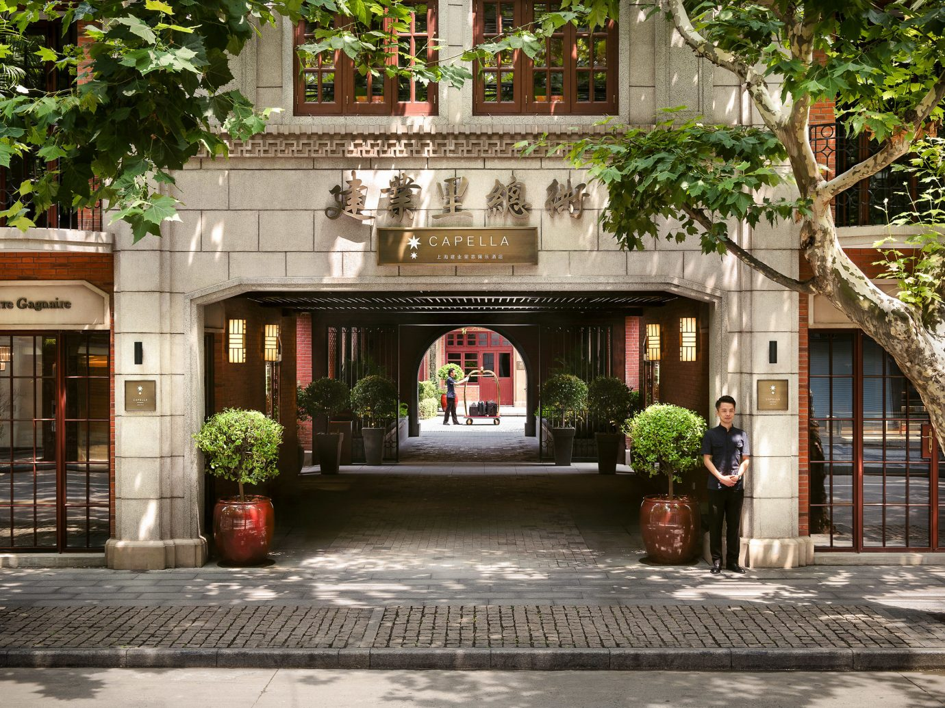 Boutique Hotels Luxury Travel tree outdoor Courtyard real estate facade house stone