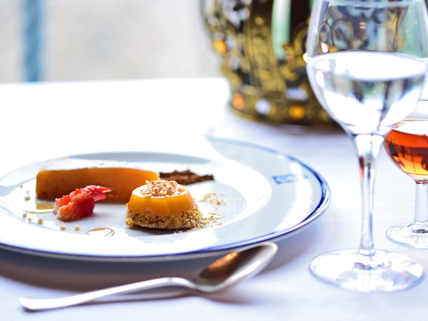 Hotels table plate wine food indoor meal dish produce dessert breakfast fruit