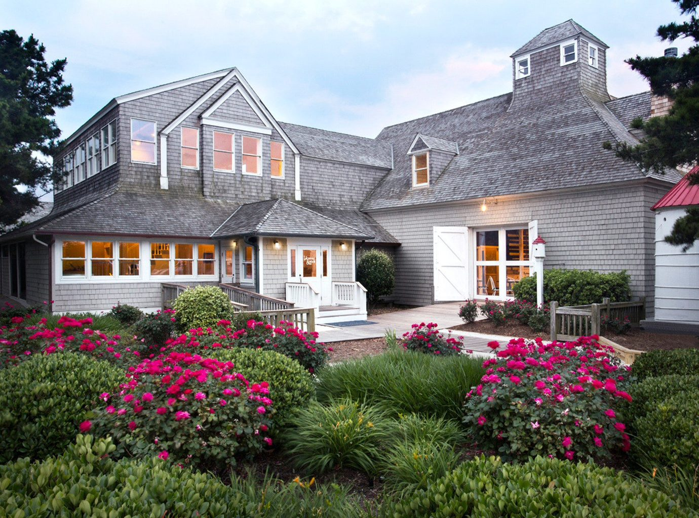 Beachfront Exterior Grounds Resort Trip Ideas Waterfront tree outdoor sky flower house property home estate building Garden cottage residential area yard lawn farmhouse backyard real estate plant facade mansion manor house Villa landscaping bushes decorated stone surrounded