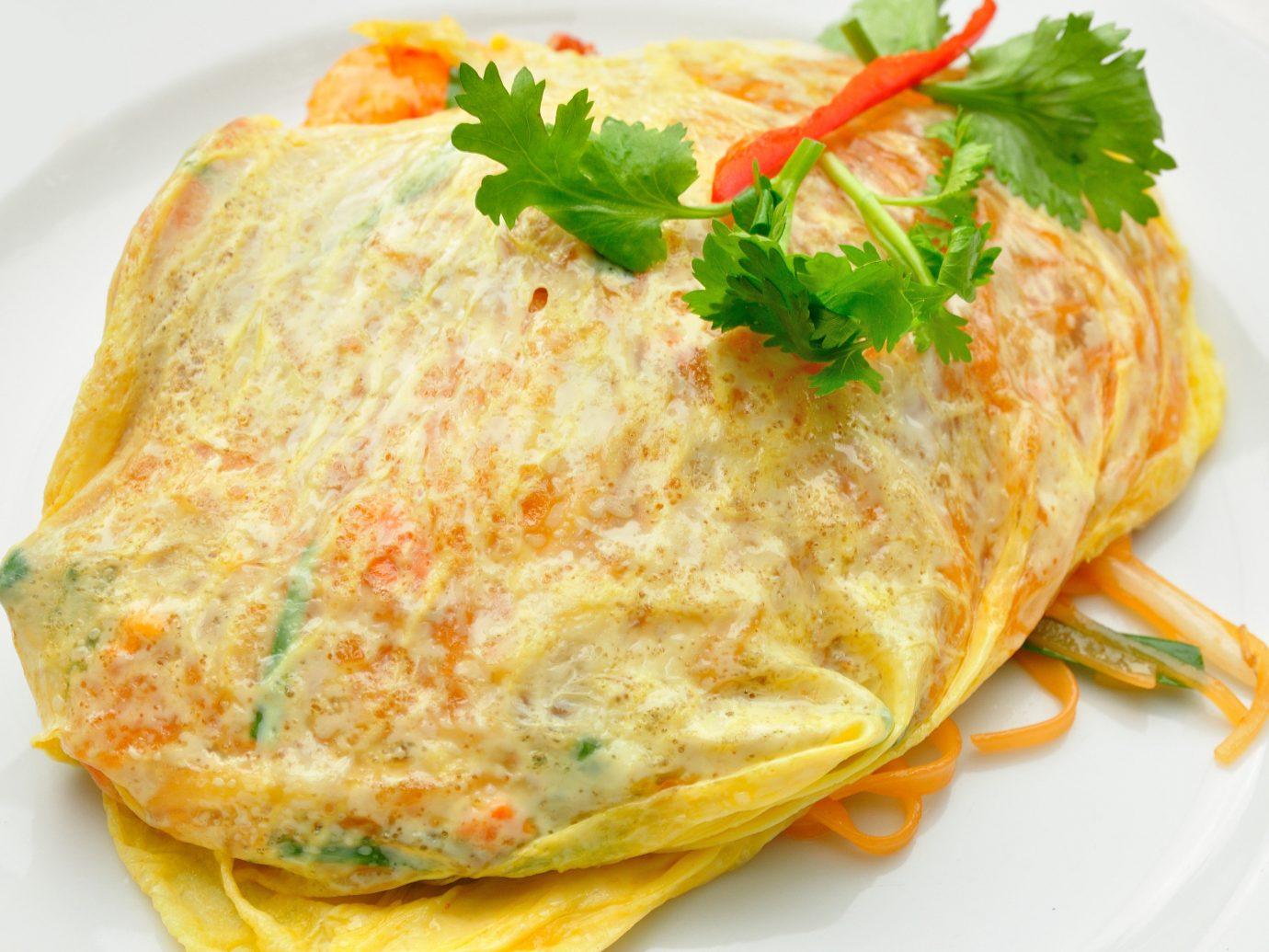 Jetsetter Guides food plate dish omelette meal breakfast cuisine omurice white fish produce tortilla de patatas frittata vegetable sauce omelet meat
