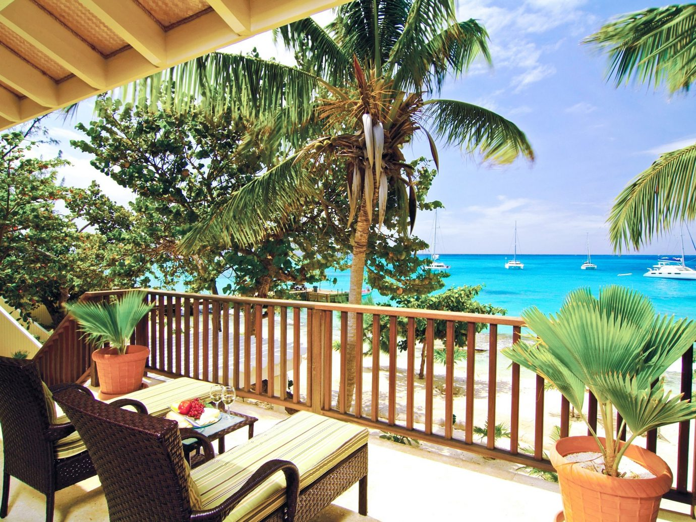 Hotels tree chair leisure property Resort caribbean vacation estate Villa plant decorated furniture real estate eco hotel palm porch Deck