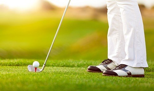 Outdoors + Adventure grass outdoor Golf golfer person sports ball game Sport pitch and putt leisure recreation outdoor recreation golf club Play individual sports professional golfer fourball