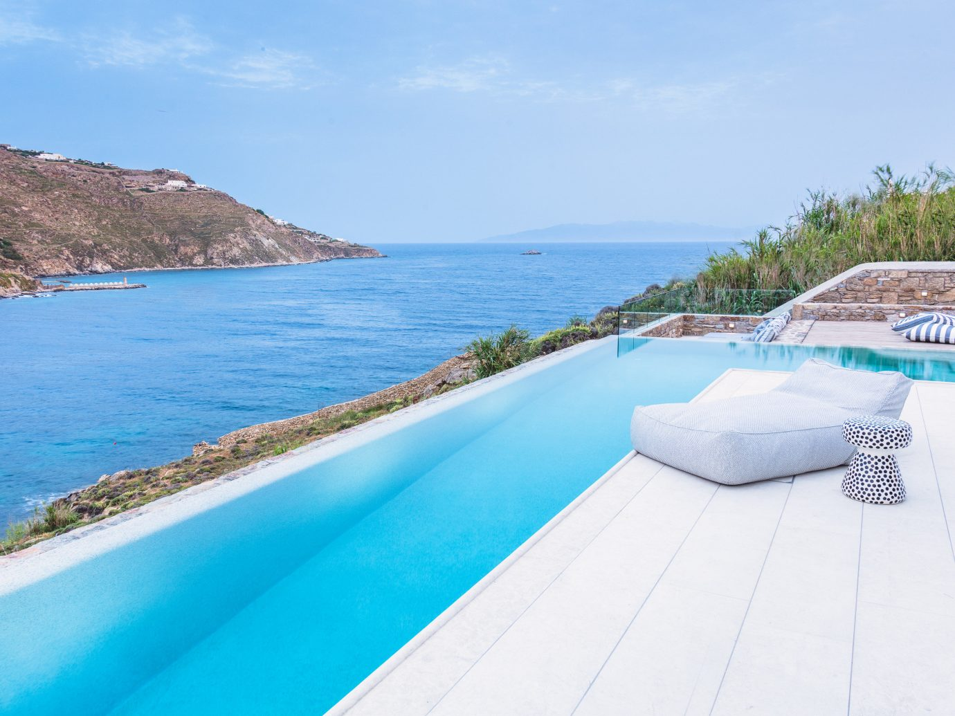 Hotels Luxury Travel sky water outdoor Nature swimming pool Beach property Sea Resort mountain leisure vacation coastal and oceanic landforms tourism bay real estate shore caribbean estate Villa amenity swimming sandy