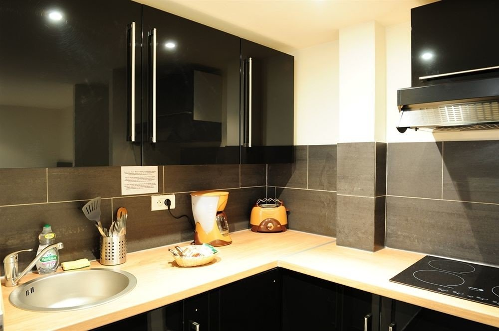 property Kitchen sink countertop home lighting Suite cabinetry counter Modern steel stainless