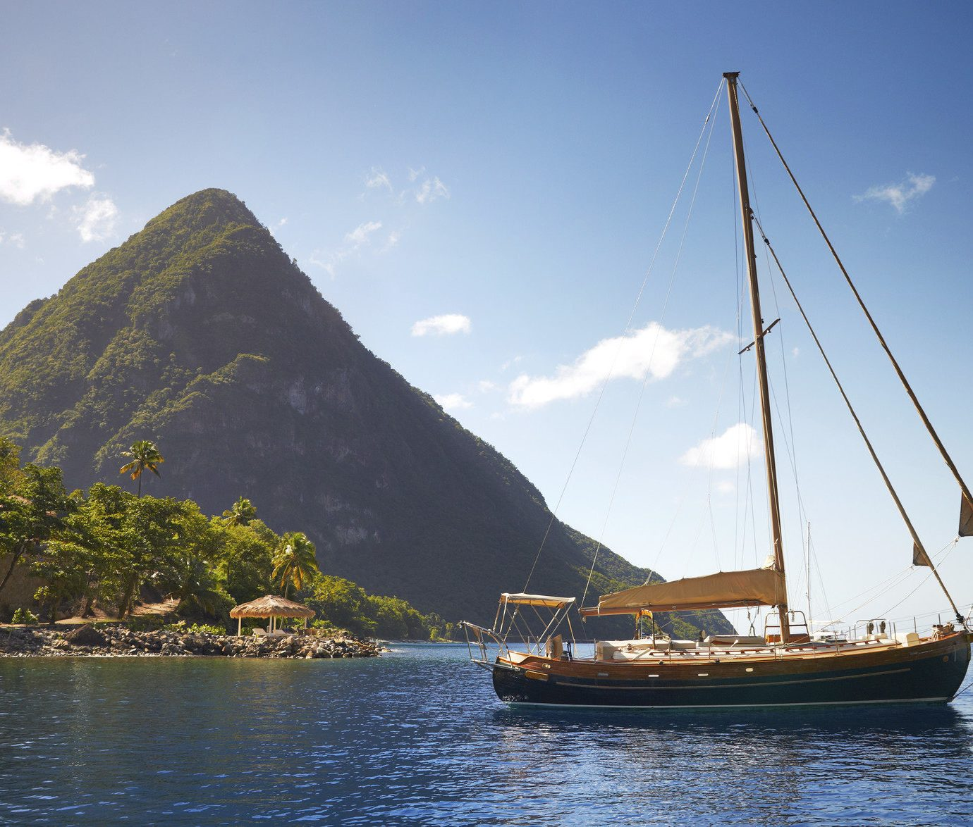 Hotels Luxury Travel Trip Ideas water Boat outdoor sky mountain watercraft vehicle transport Sea ship sailing vessel Lake bay floating sailboat background Coast schooner sailing sail shore day