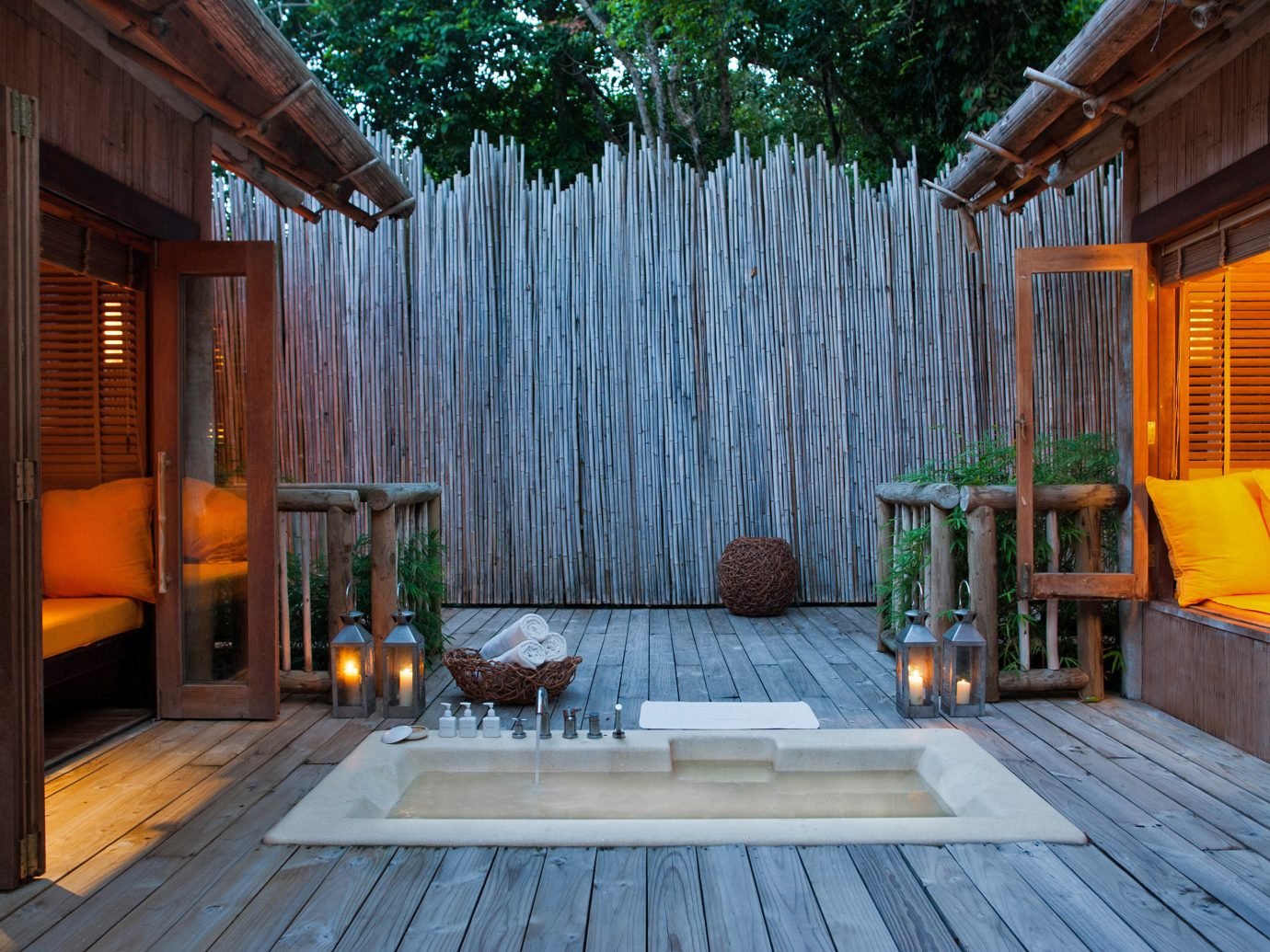 Health + Wellness Hotels Yoga Retreats building wooden house property backyard estate porch swimming pool home Architecture outdoor structure Deck Resort cottage wood Courtyard interior design facade Villa mansion yard stone floor furniture
