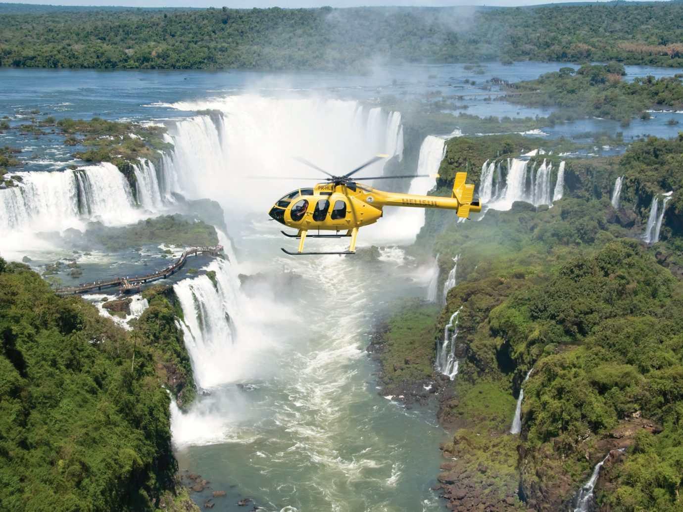 Helecopter Going Over Waterfall In Brazil By Belmond Hotel, Iguacu National Park