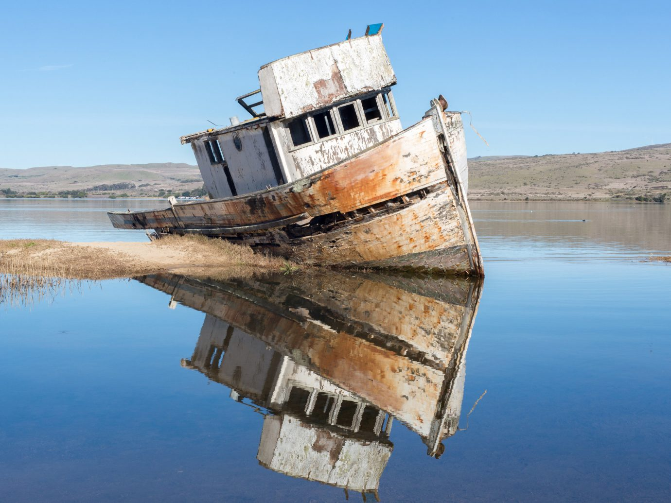 Trip Ideas water sky outdoor vehicle Boat ship watercraft Sea reflection shipwreck transport channel Coast Lake waterway terrain old shore