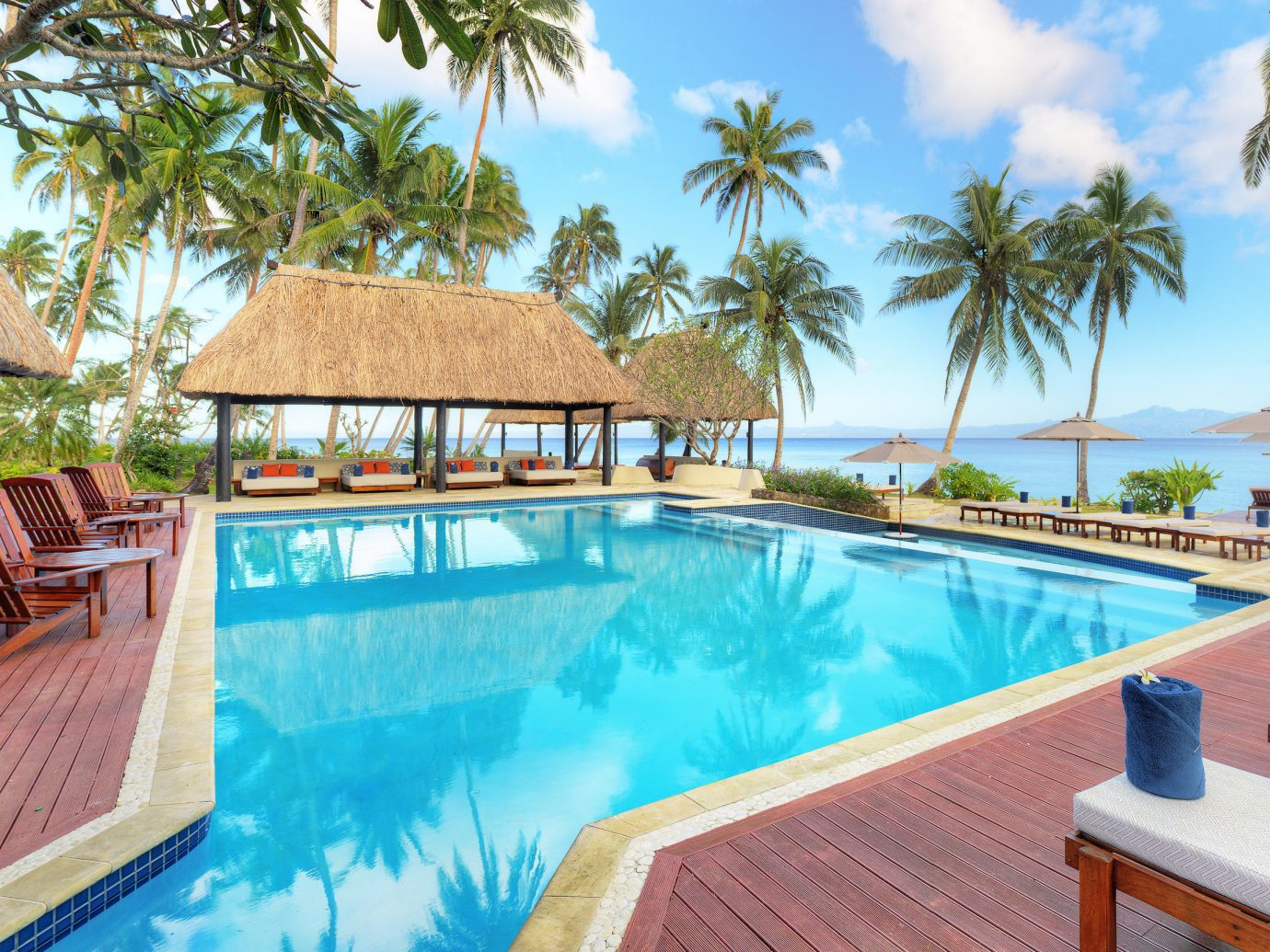 All-Inclusive Resorts Family Travel Hotels tree outdoor Resort property swimming pool chair leisure wooden building estate real estate Pool Villa vacation resort town caribbean palm tree cottage hacienda tropics arecales hotel wood furniture