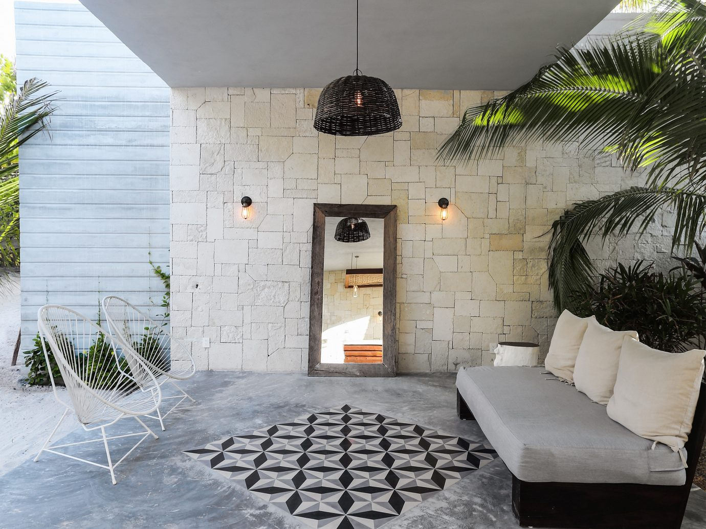 City Mexico Trip Ideas Tulum property wall house floor home Courtyard backyard hearth estate cottage interior design Patio flooring living room outdoor structure farmhouse porch Villa hacienda