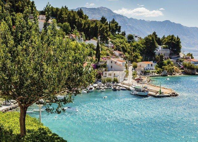 tree water sky property Resort swimming pool resort town Lake Villa Lagoon surrounded day shore