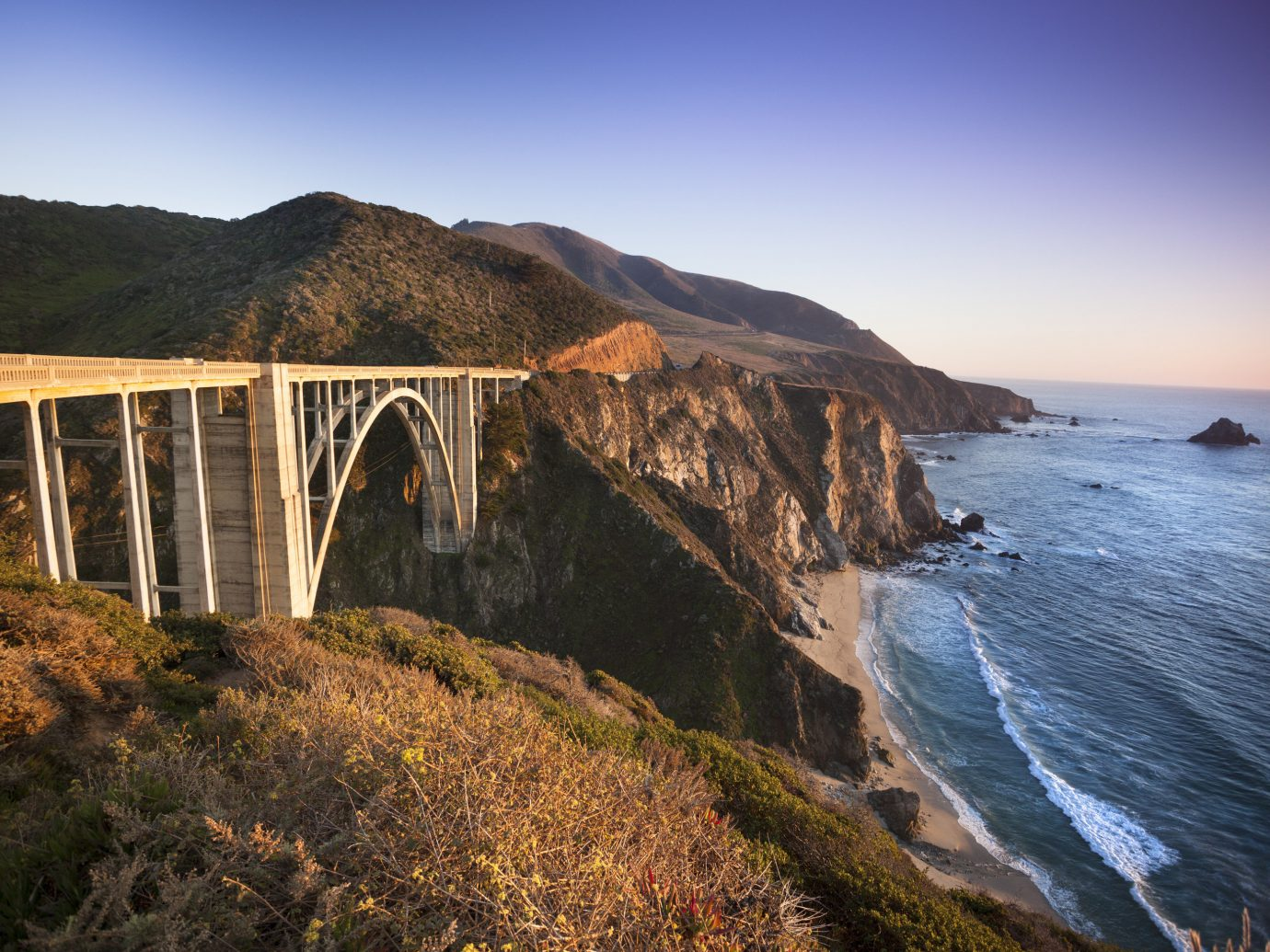 Offbeat Trip Ideas outdoor sky mountain grass Coast body of water Sea bridge water Ocean rock Nature cliff shore landscape terrain bay wave reservoir hillside