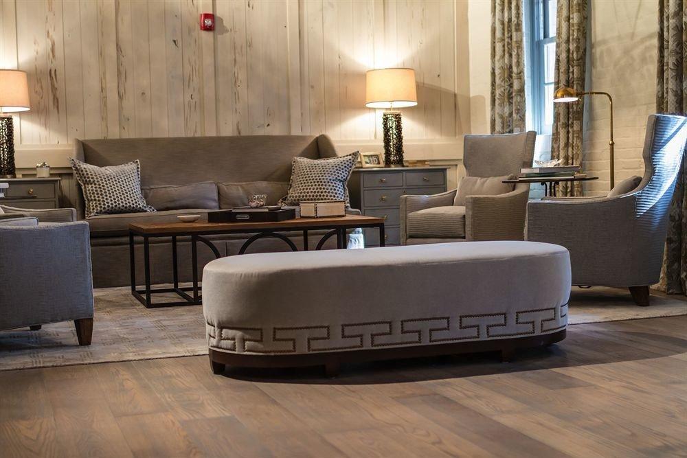 living room property Lobby home flooring hardwood couch wood flooring Suite