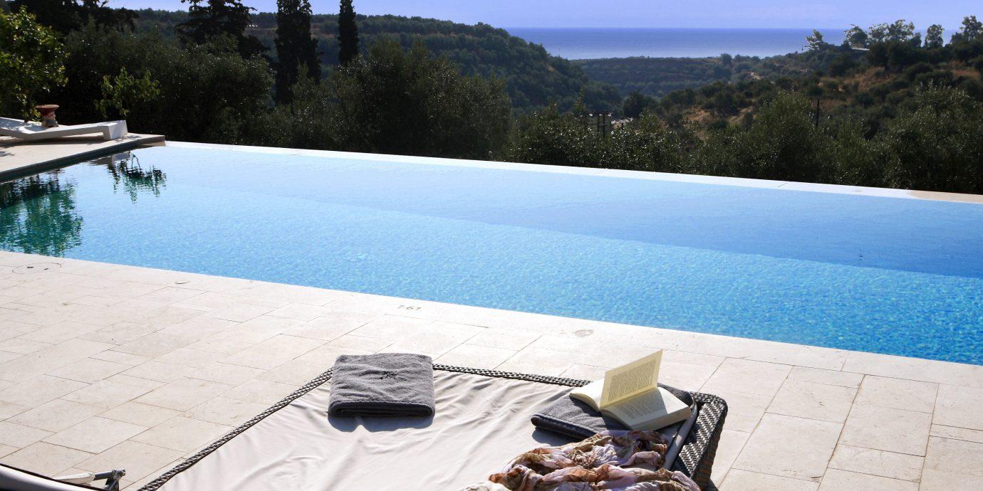 Lounge Nature Outdoors Patio Pool Scenic views Terrace tree sky swimming pool leisure Picnic vehicle Villa dock Sea Resort