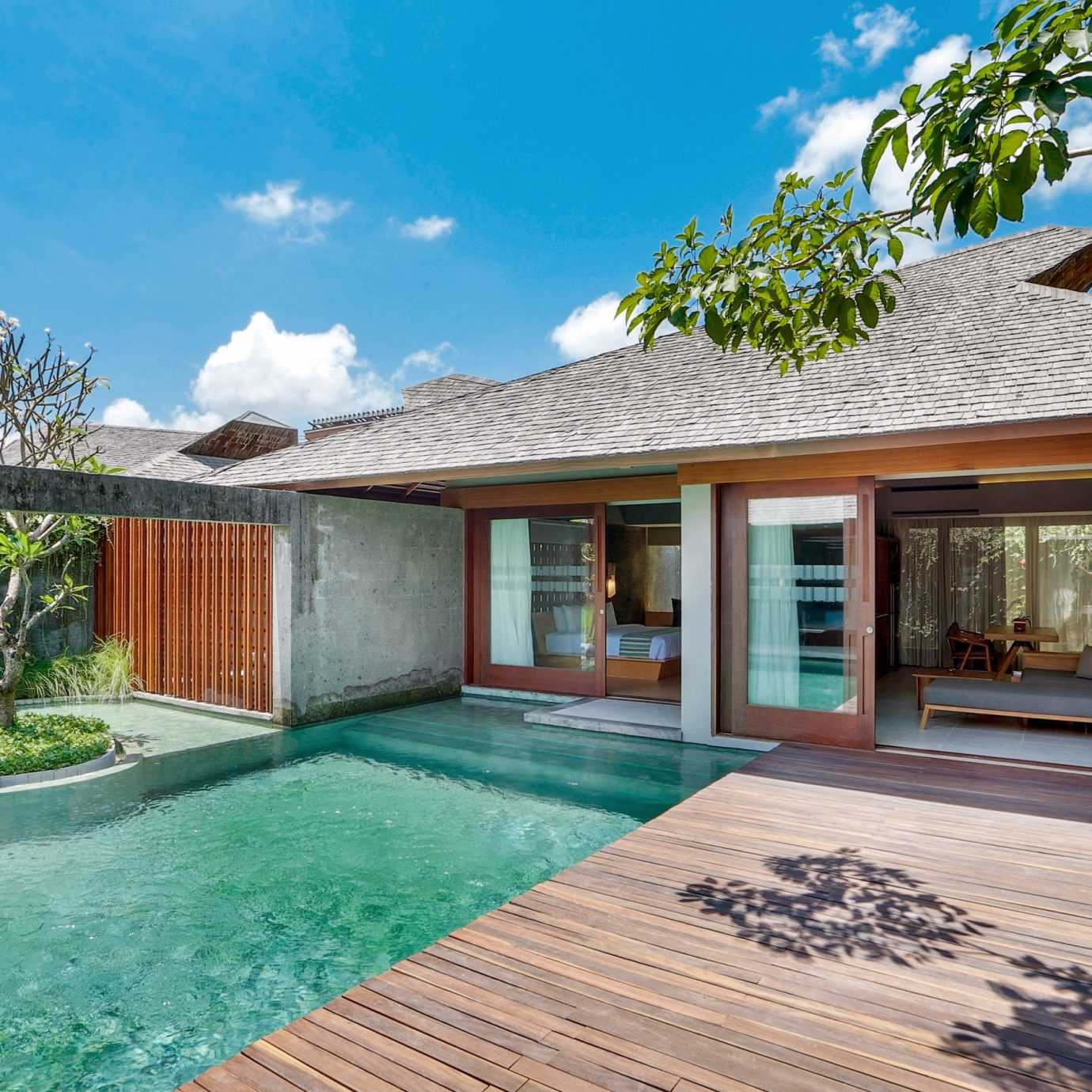 Lounge Pool Tropical sky property swimming pool building house home Villa Resort backyard cottage condominium mansion stone