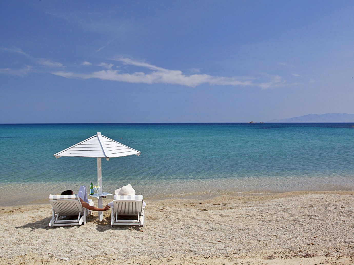 Beach Beachfront Budget Island Lounge Outdoor Activities Outdoors Scenic views Waterfront sky outdoor water shore Sea Ocean body of water horizon Nature Coast vacation sand bay cape caribbean sandy day