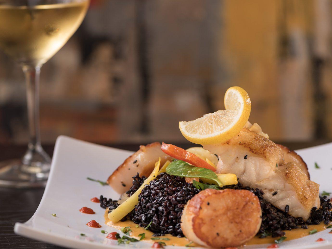 table food indoor plate dish restaurant meal fish cuisine dinner brunch produce sense piece de resistance