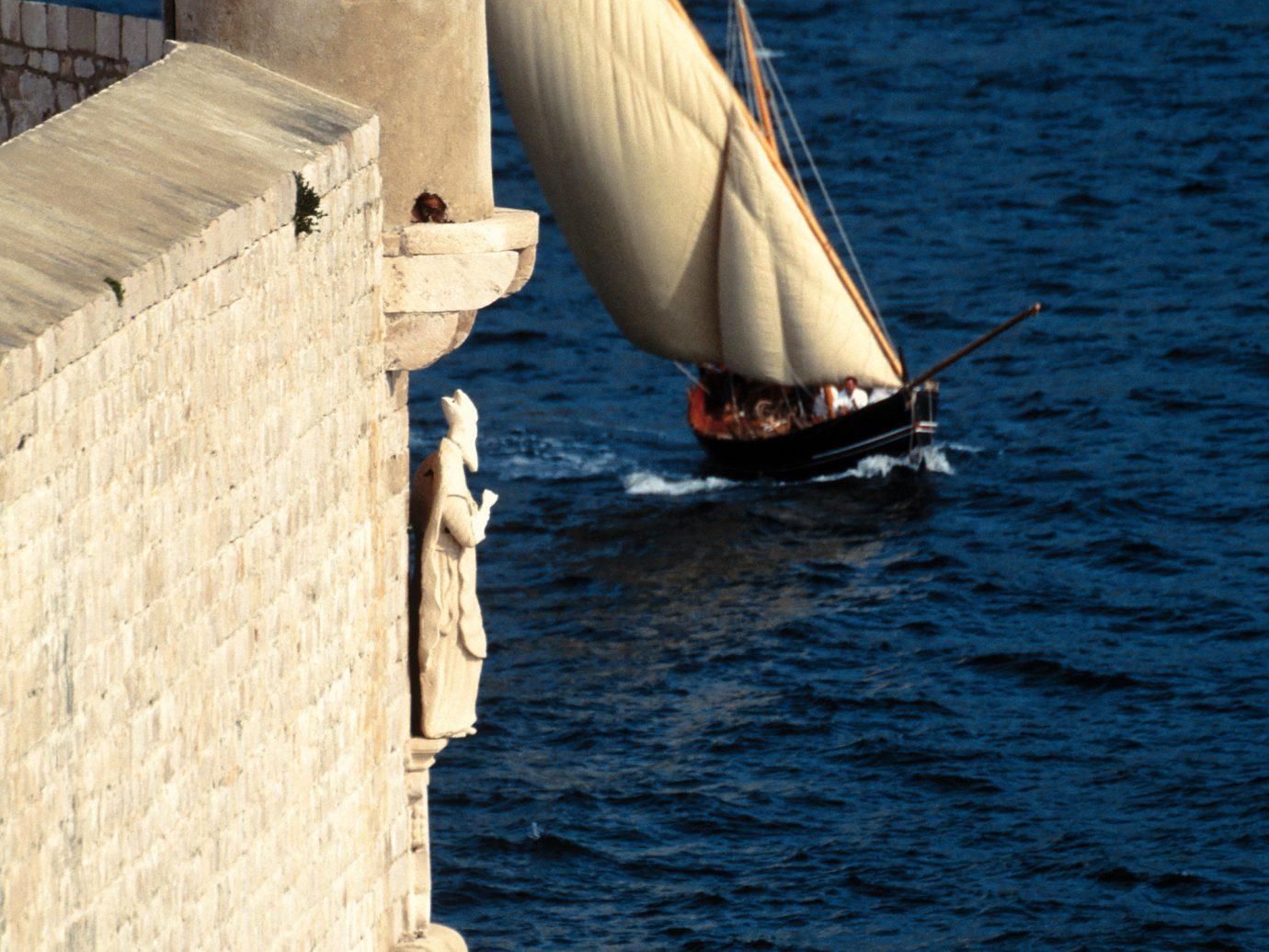Offbeat water outdoor vehicle blue Sea Boat tower Ocean sail watercraft Coast sailing ship mast sailboat sailing vessel