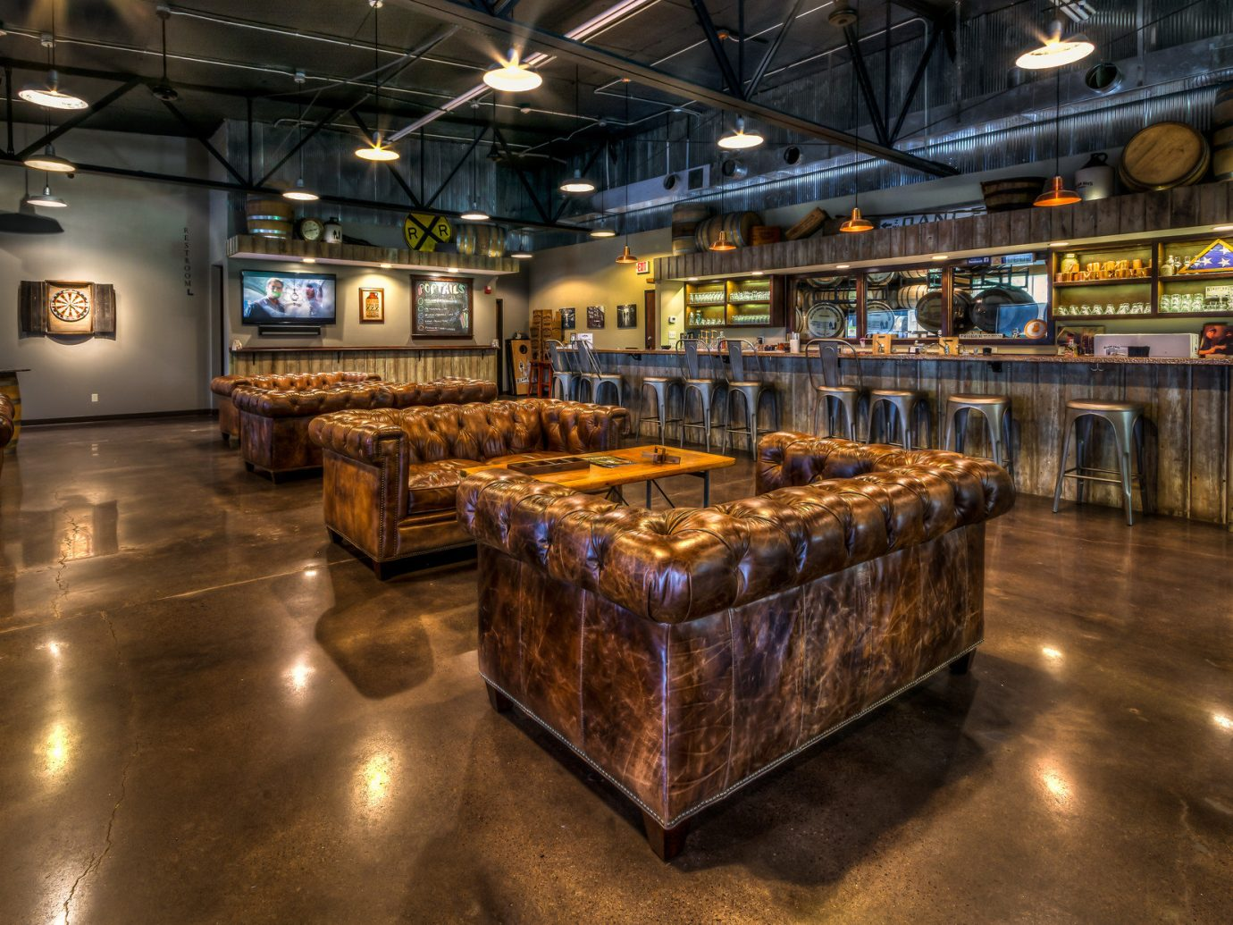 ambient lighting artistic artsy Bar bar seating distillery Hip industrial interior trendy Trip Ideas Weekend Getaways indoor floor ceiling building Lobby factory interior design retail stall tourist attraction