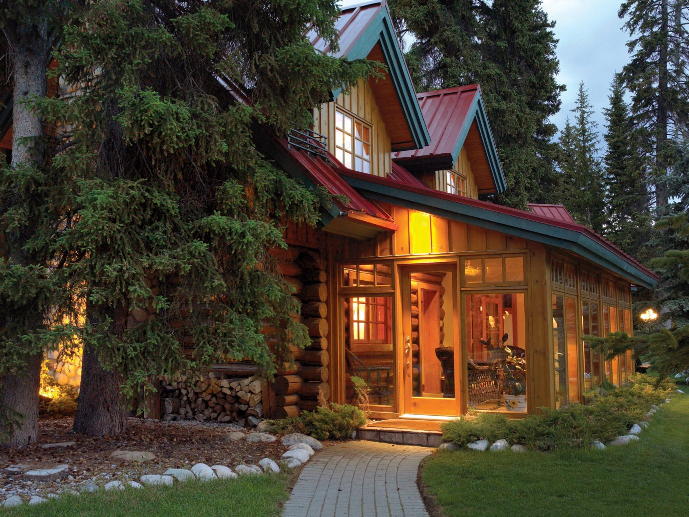 Alberta Architecture Boutique Hotels Canada Exterior Hotels Nature Rustic Scenic views home house cottage log cabin tree plant real estate lighting estate landscape outdoor structure facade evening building siding landscaping