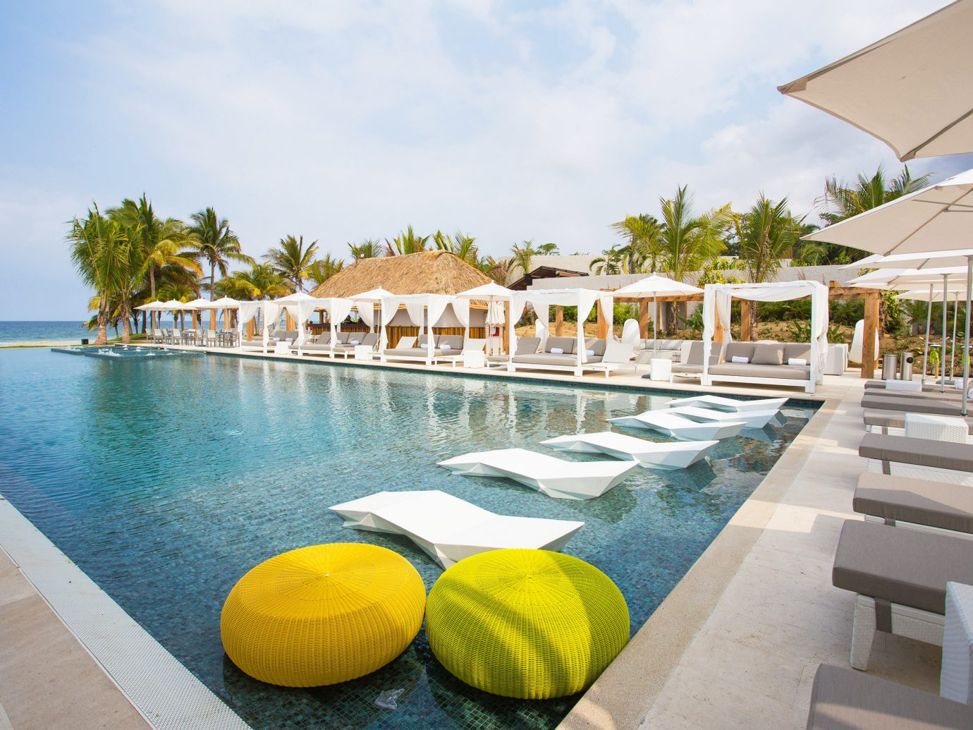Influencers + Tastemakers Travel Shop Trip Ideas sky outdoor water leisure swimming pool property Pool Resort vacation estate Villa caribbean condominium swimming