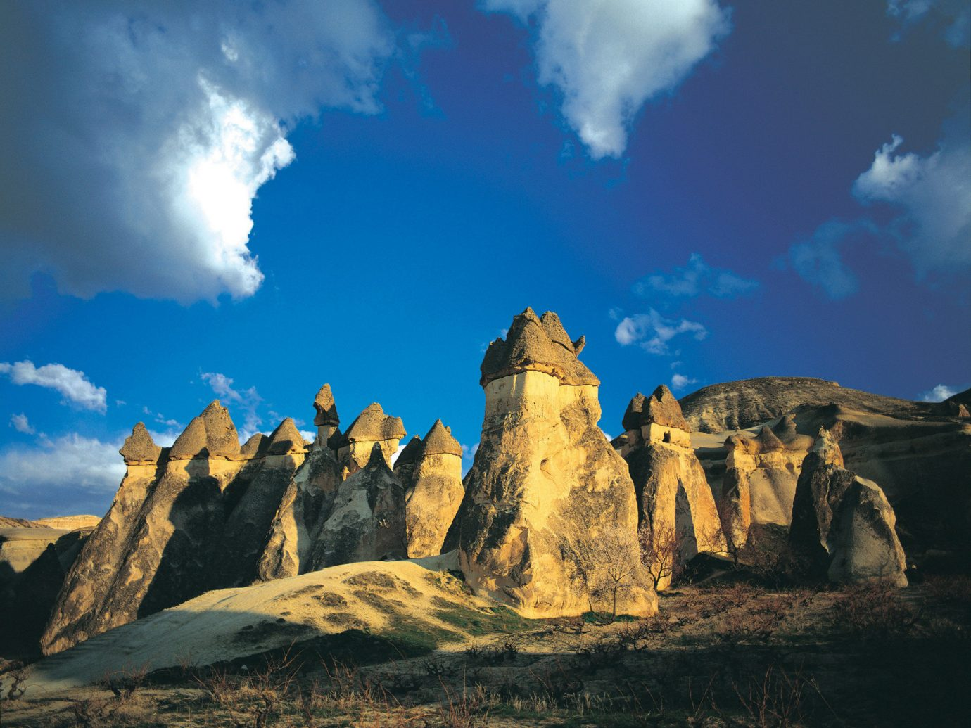 Budget sky outdoor mountainous landforms Nature landform geographical feature cloud landmark mountain rock badlands valley landscape hill butte mountain range plateau clouds terrain formation arch cliff geology day