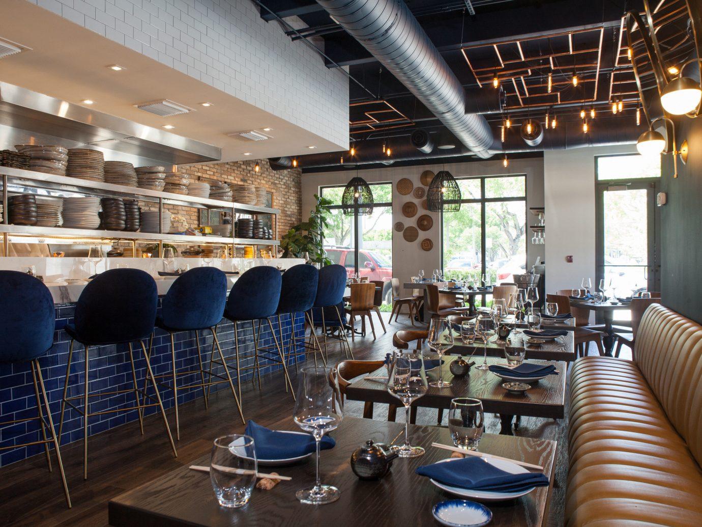 Food + Drink indoor chair restaurant ceiling interior design room café area furniture several dining room