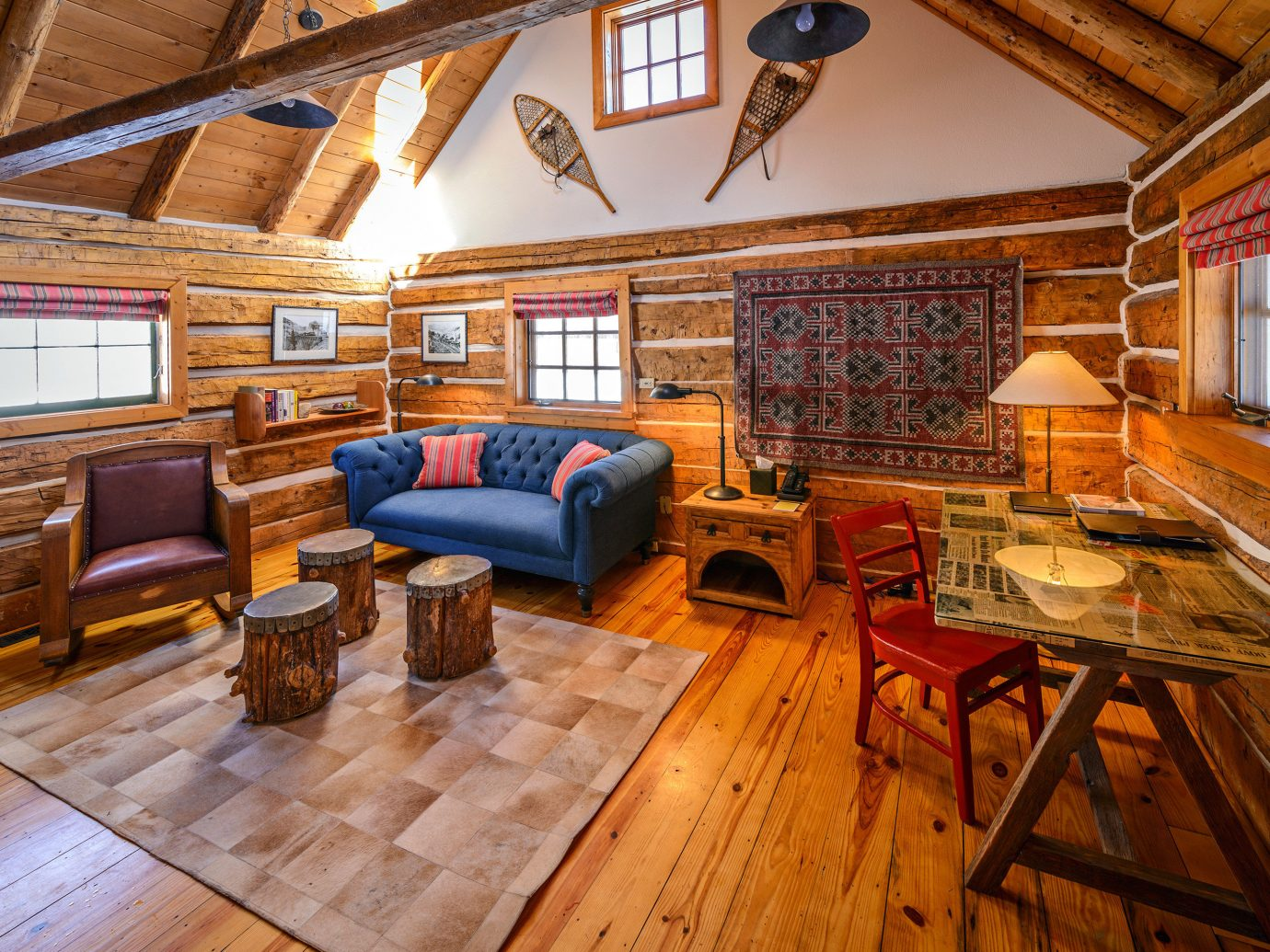 Adventure All-Inclusive Resorts Glamping Hotels Living Romance Rustic floor indoor room property log cabin building recreation room estate ceiling house home cottage hardwood living room wood interior design farmhouse furniture real estate wood flooring