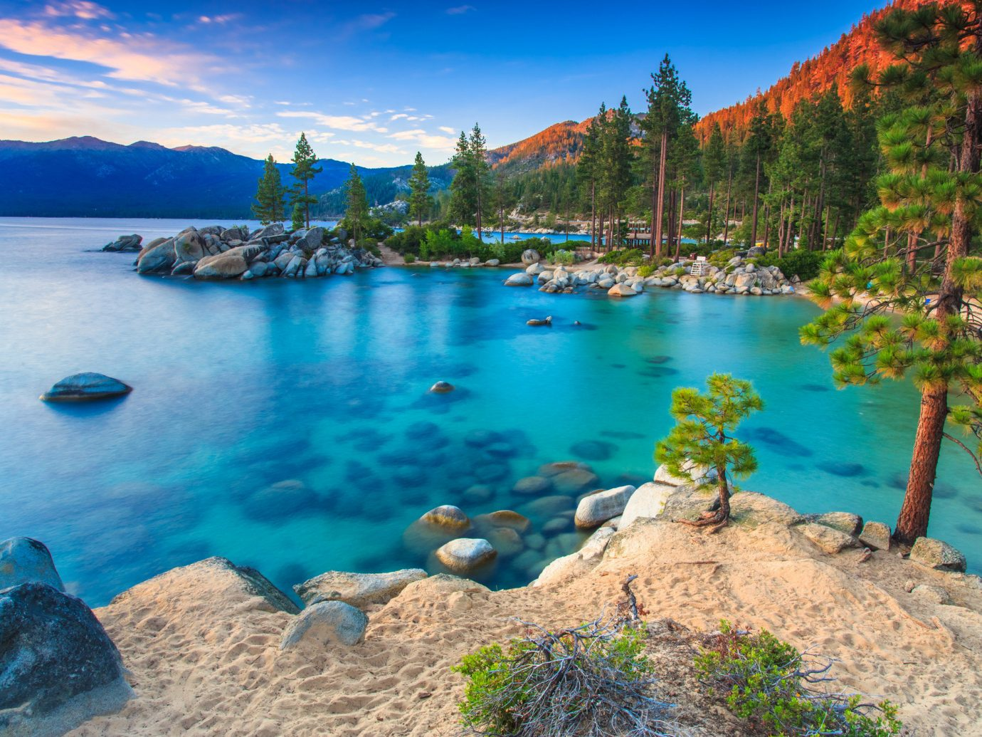 Beach Hotels Lakes + Rivers water outdoor sky Nature mountain rock body of water River Lake Sea surrounded bay canyon Lagoon shore