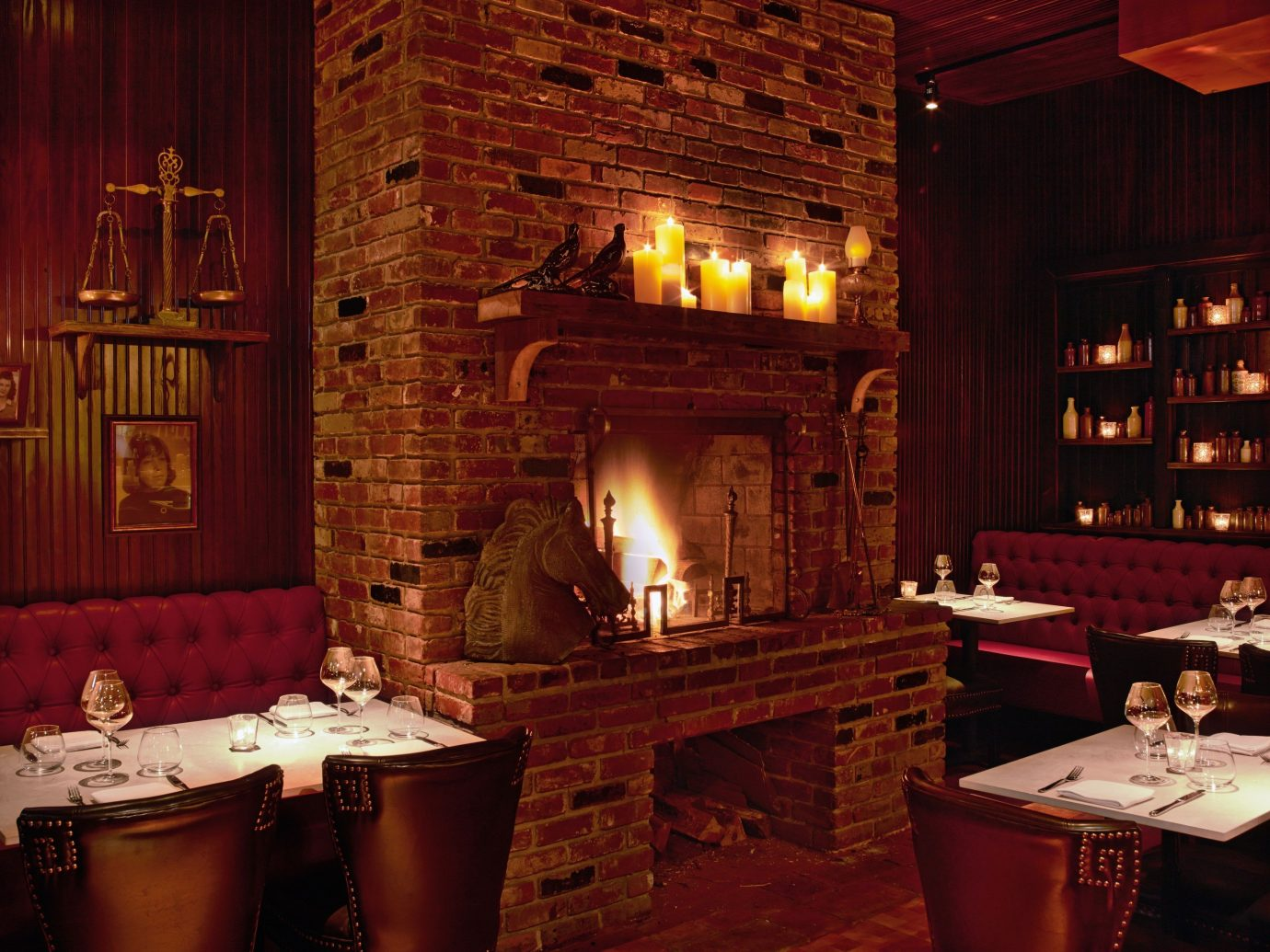 Food + Drink indoor room restaurant lighting interior design Bar estate Fireplace decorated