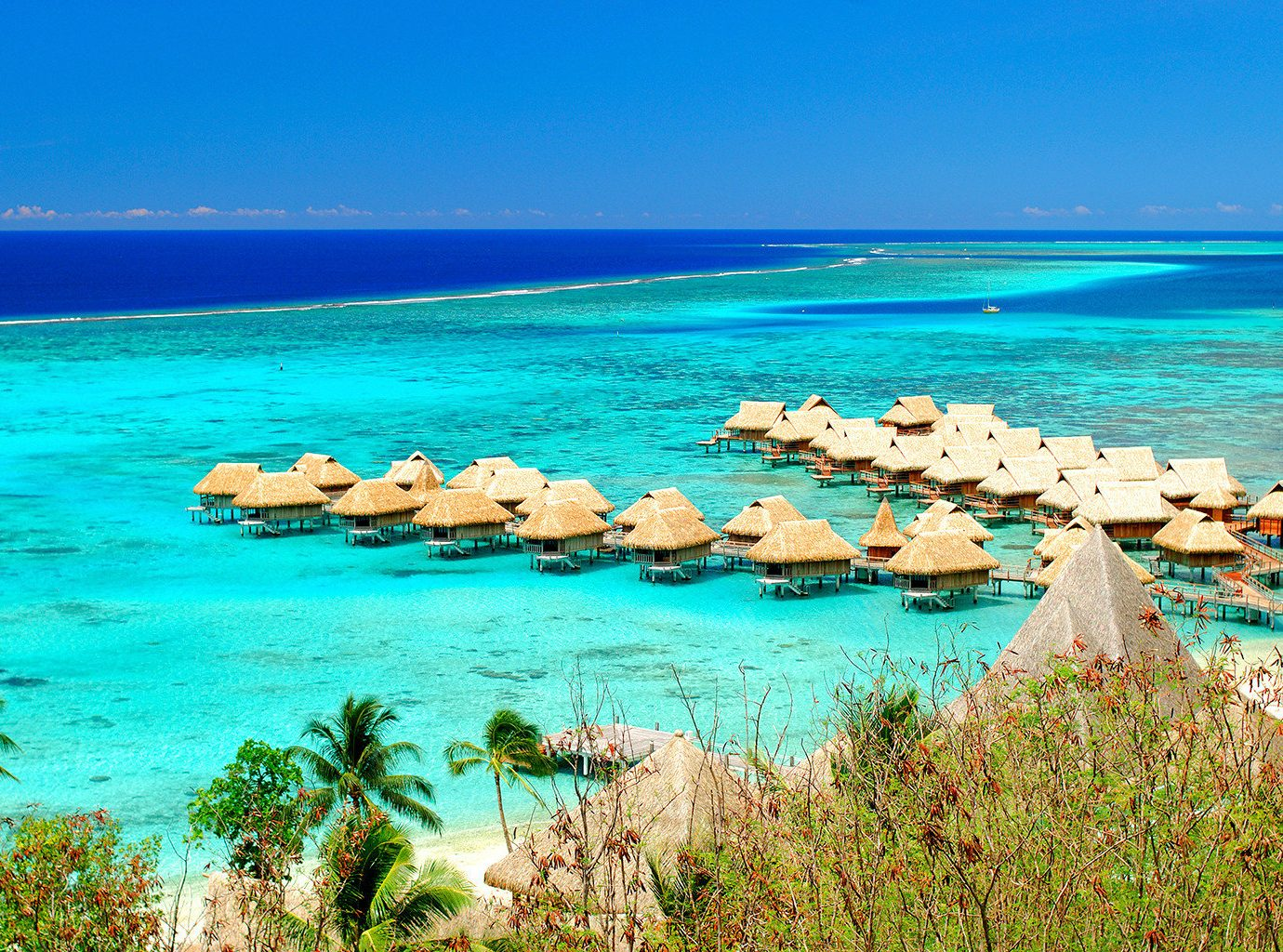 All-Inclusive Resorts Architecture Boutique Hotels Buildings Exterior Hotels Luxury Overwater Bungalow Resort Romance Scenic views water sky outdoor shore Sea Nature Beach body of water Coast Ocean horizon vacation blue caribbean islet bay Lagoon cape Island tropics cove archipelago sand