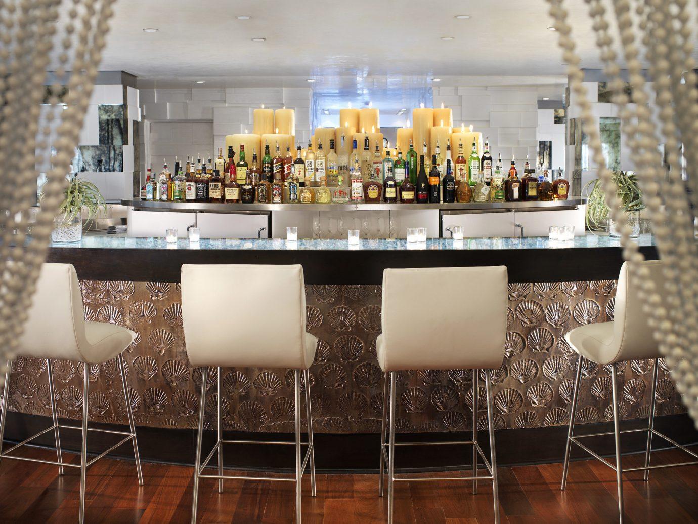Food + Drink indoor room meal interior design restaurant table Design dining room centrepiece Bar several dining table