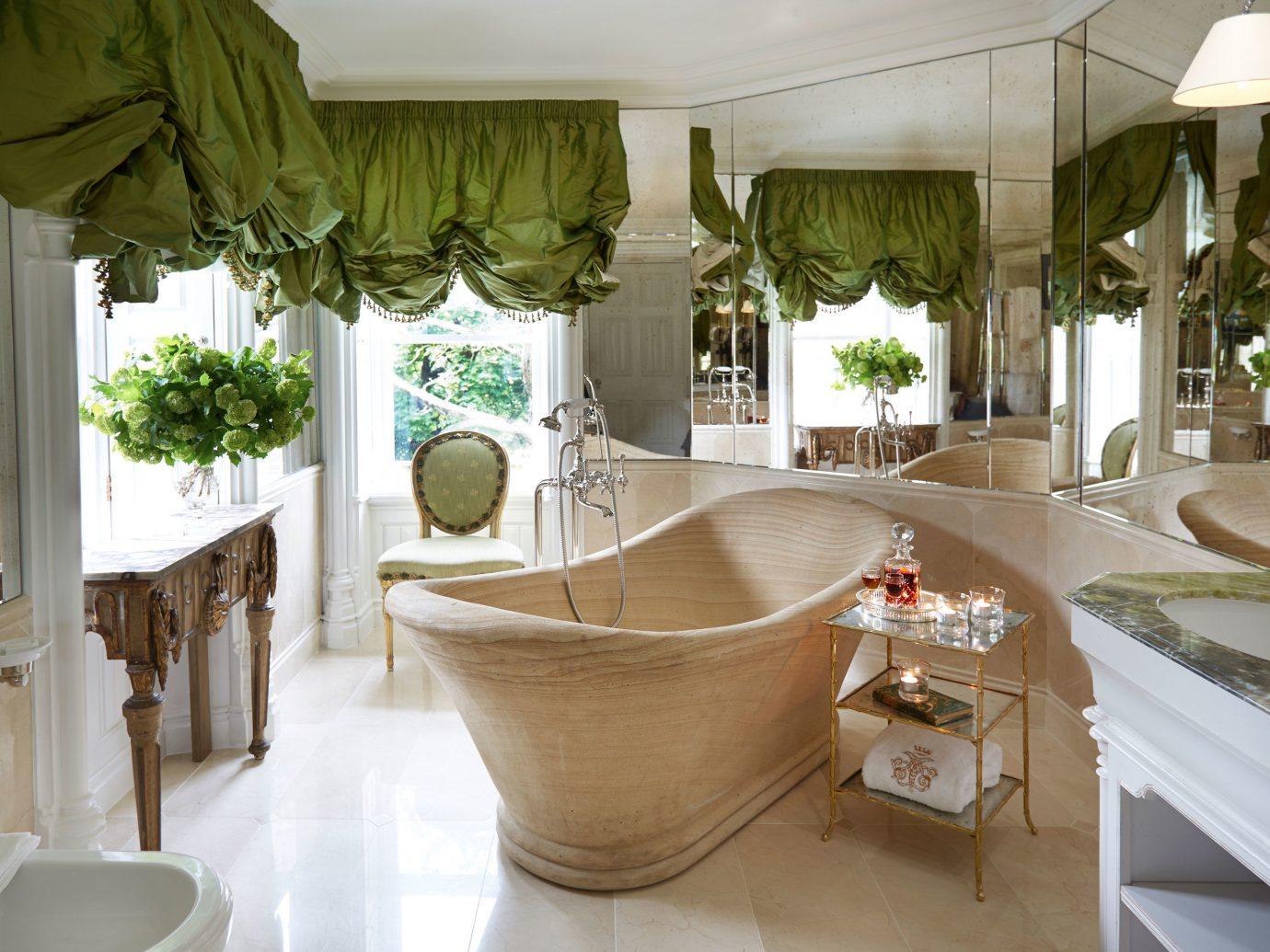 Hotels indoor room property estate home interior design Design restaurant Villa Suite bathroom Resort mansion dining room condominium apartment furniture tub Bath