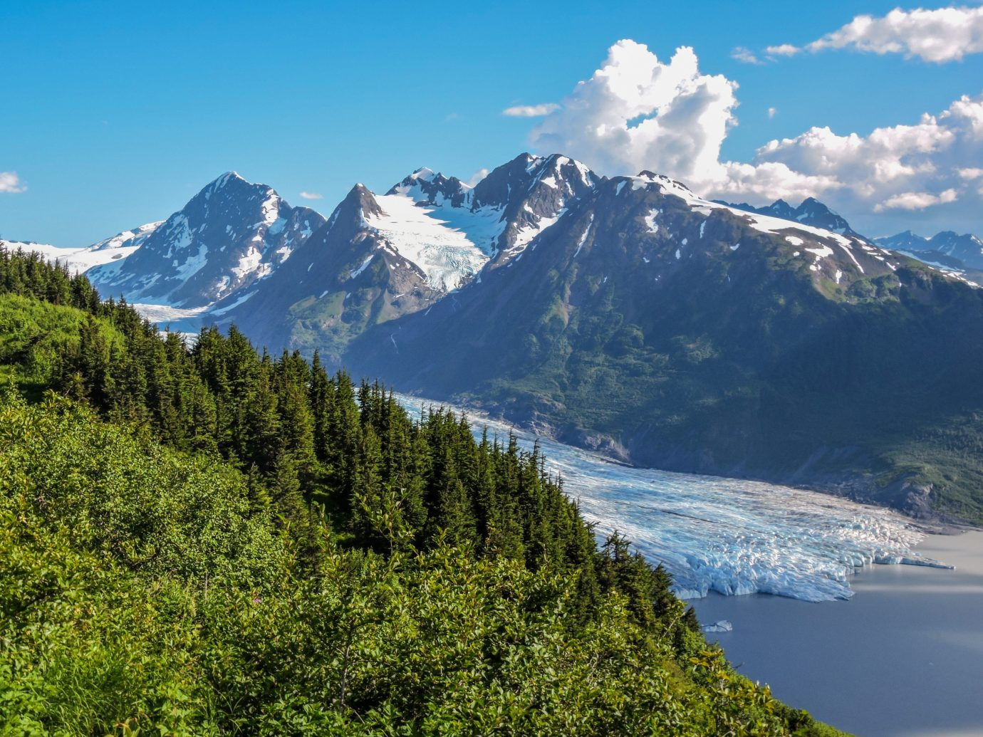 Outdoors + Adventure mountain outdoor sky tree highland snow mountainous landforms Nature mountain range geographical feature landform wilderness fell ridge alps fjord Lake background mountain pass loch landscape Adventure meadow walking plateau glacial landform national park distance