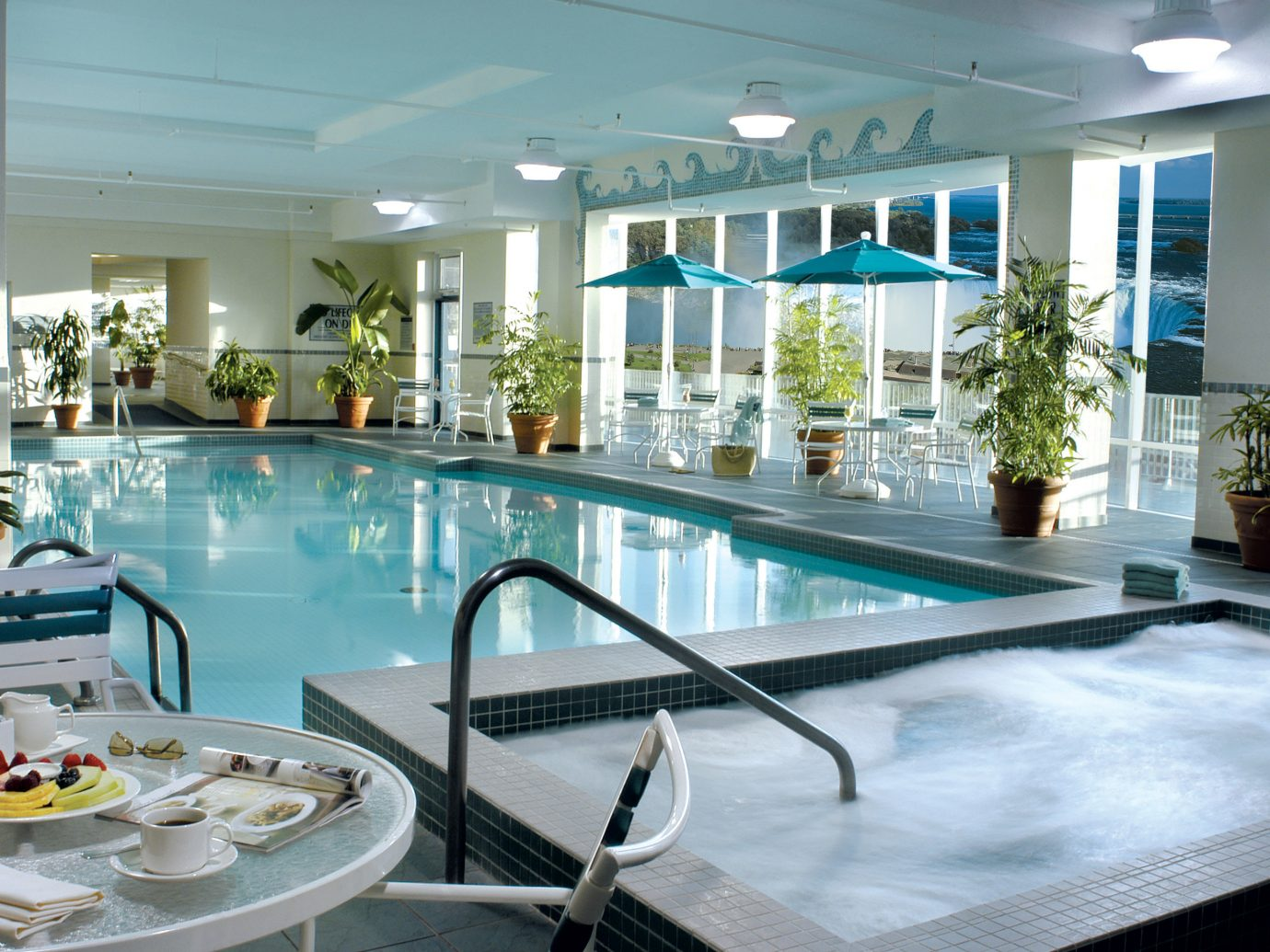 Hotels table indoor swimming pool property ceiling leisure window leisure centre Resort real estate apartment condominium Dining interior design hotel estate amenity resort town penthouse apartment dining table