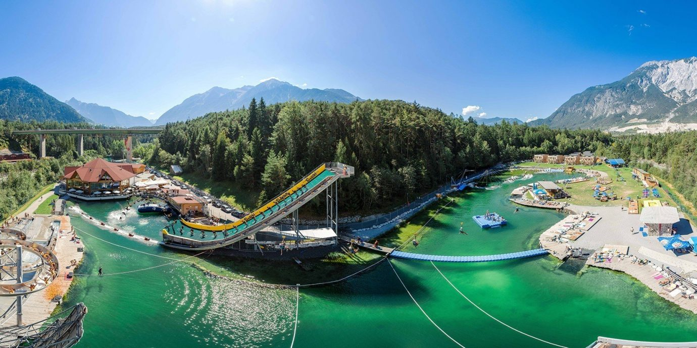 Trip Ideas mountain sky Boat outdoor leisure amusement park green Nature park tourism outdoor recreation aerial photography Resort Water park mountain range recreation nonbuilding structure docked colorful several