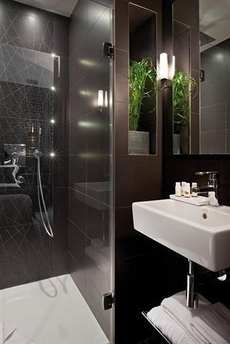 bathroom mirror sink toilet plumbing fixture bidet bathtub tiled tile Modern