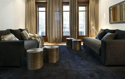 sofa property living room home Suite hardwood condominium cottage flooring rug Modern