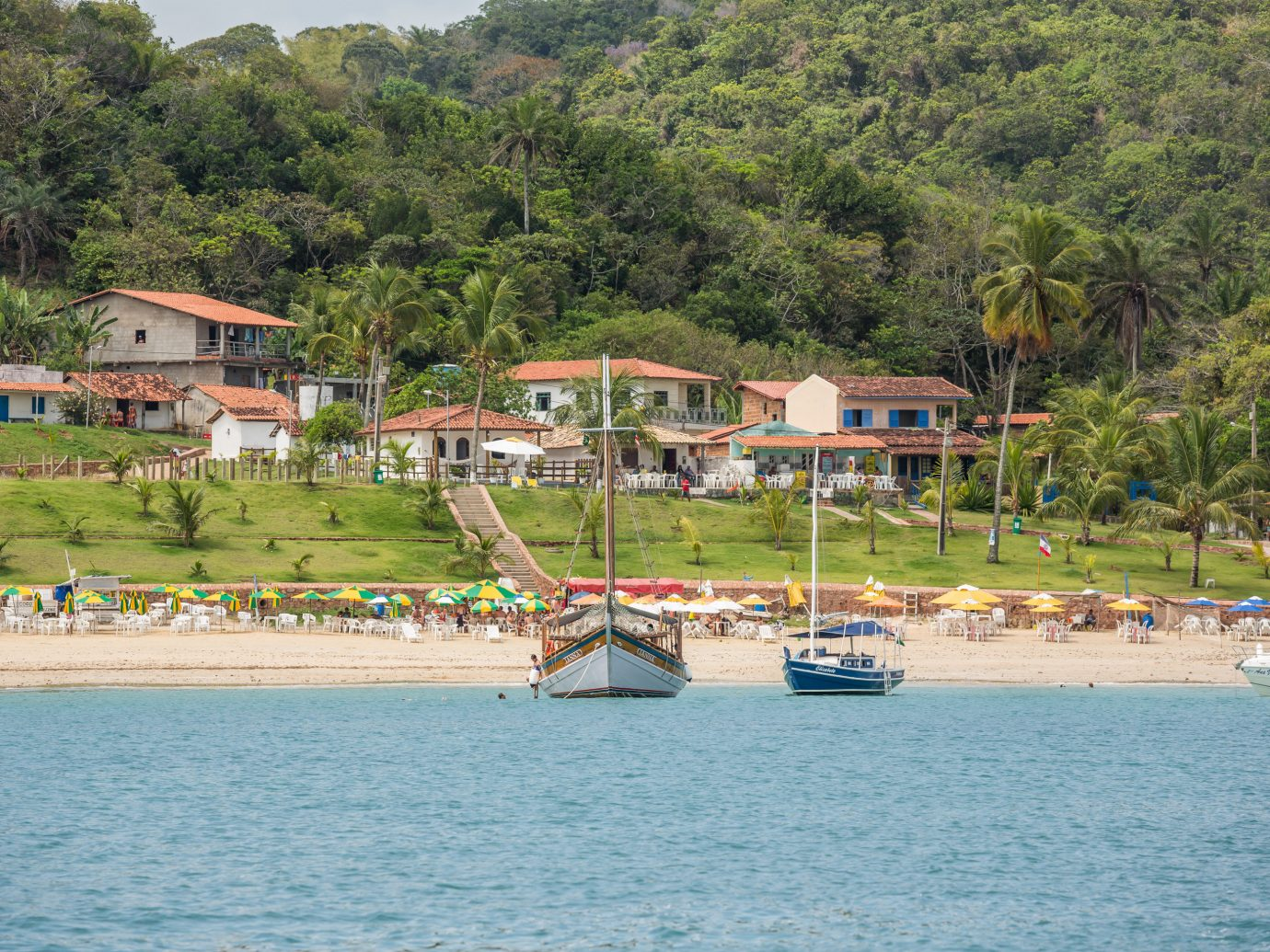Beaches Brazil Trip Ideas outdoor tree water Boat body of water Sea vacation Beach vehicle bay Coast Island boating caribbean lined shore several