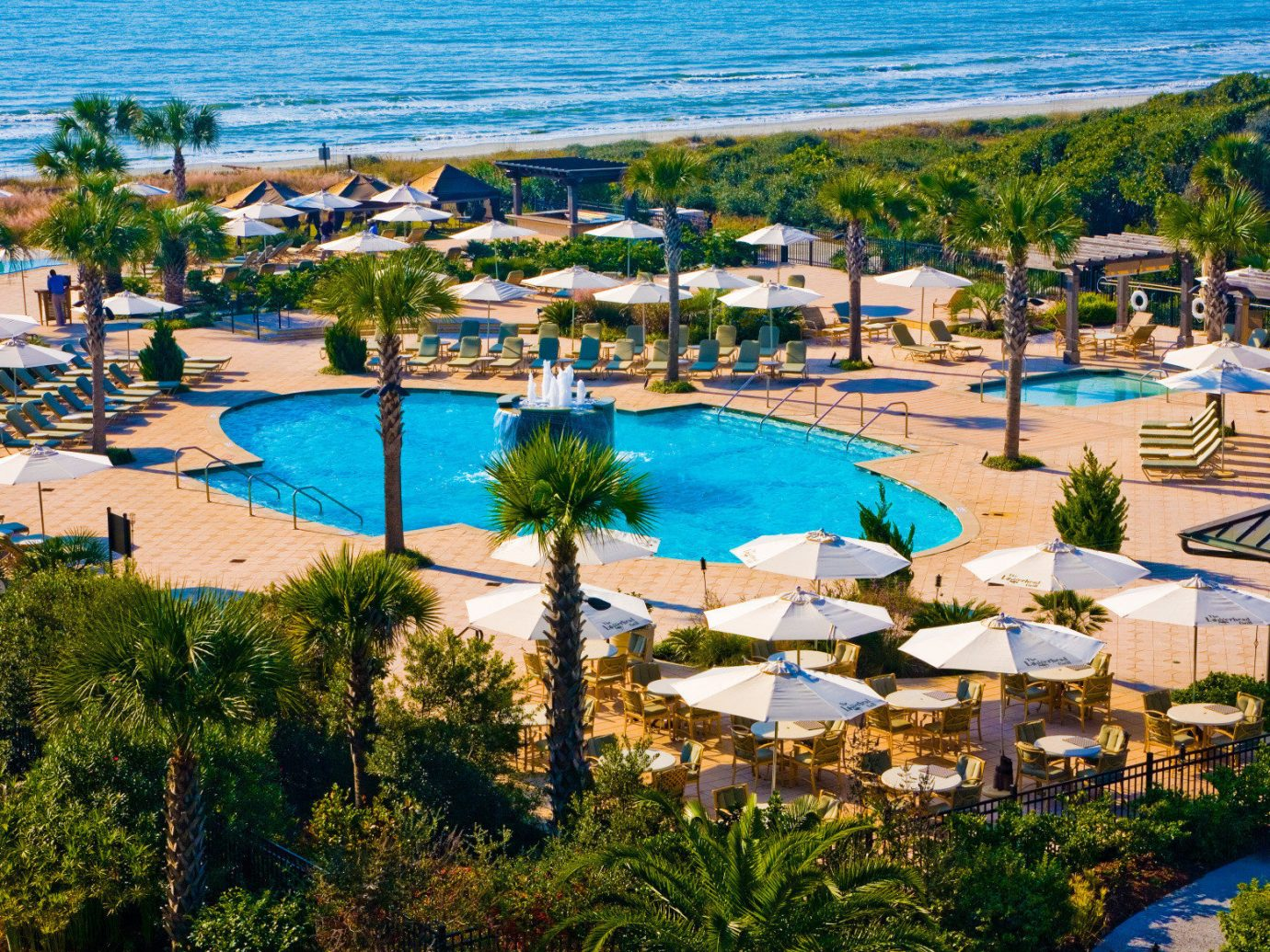 East Coast USA Trip Ideas outdoor water tree umbrella Resort leisure swimming pool Beach property lawn estate vacation marina Nature resort town dock Water park bay Village several shore swimming lined sandy