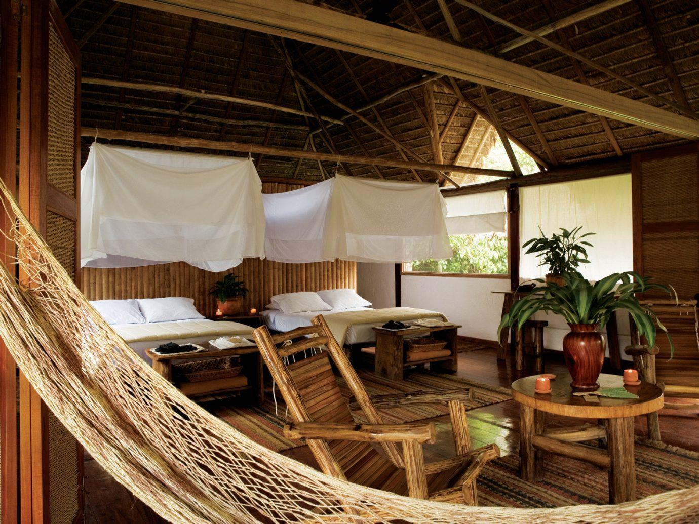 Hotels indoor chair room Resort estate interior design bed home cottage furniture several